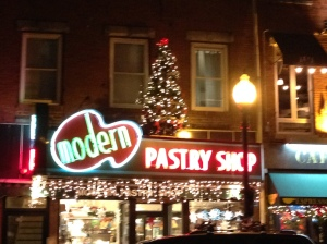 The front of Modern Pastry Shop as seen in the evening